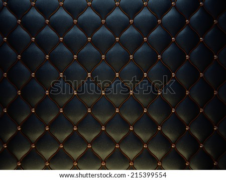 Black leather pattern with golden wire and diamonds. Bumped background - stock photo