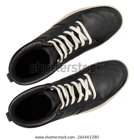 Black leather sneakers isolated on white background. With clipping path - stock photo