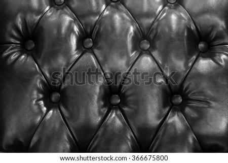 black leather sofa background - stock photo