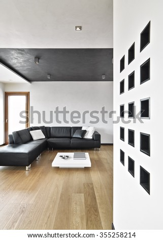black leather sofa in the modern living room wit wood floor - stock photo