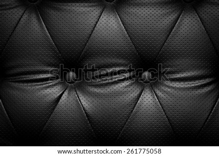 Black leather texture with buttons - stock photo