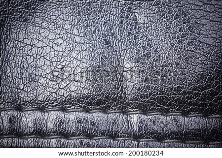 Black leather texture with sew. - stock photo
