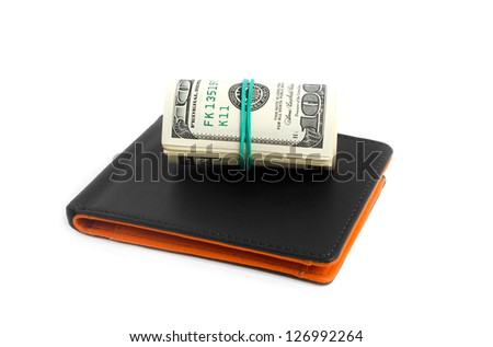 Black leather wallet and dollars on white background