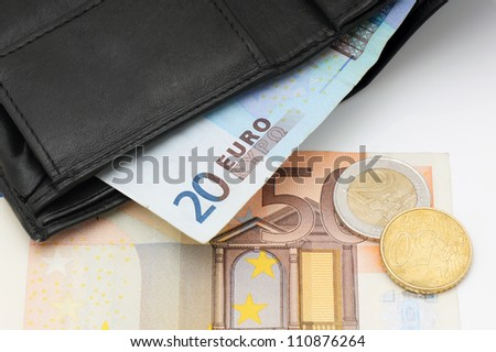Black leather wallet and money euro. - stock photo