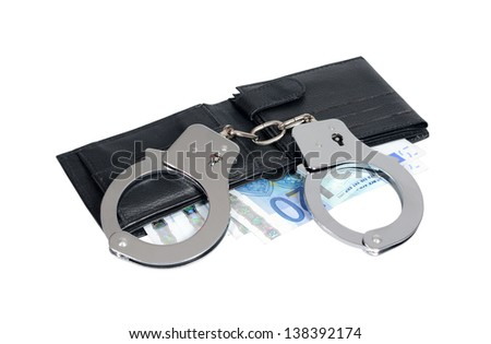 Black leather wallet with handcuffs isolated over white, clipping path included. - stock photo