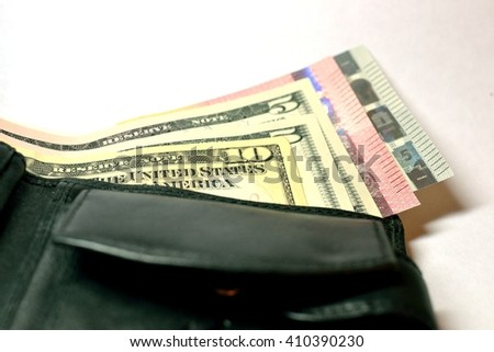 black leather wallet with money isolated on white background - stock photo