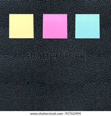 black leather with yellow note - stock photo