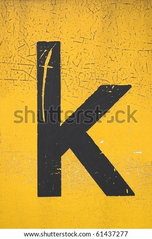 Black letter k on yellow grungy background