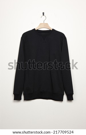 black long shirts with wood hanger isolated white. - stock photo