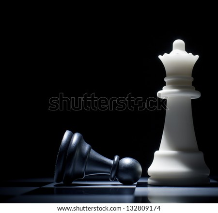 Black lost. Pawn at the feet of the Queen - stock photo