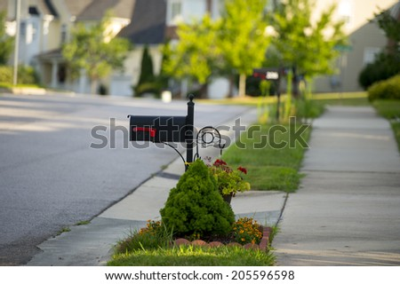 Black Mail Box in Front of a House - stock photo