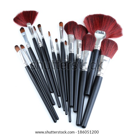 Black make-up brushes isolated on white