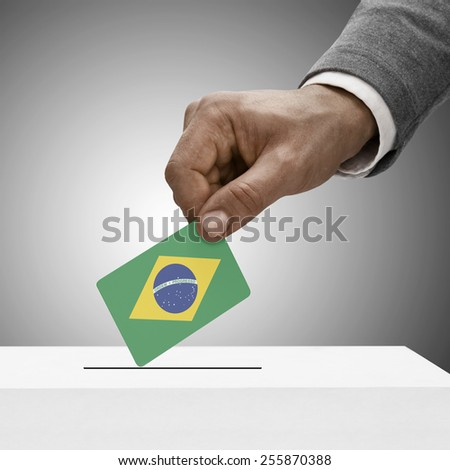 Black male holding flag. Voting concept - Brazil - stock photo