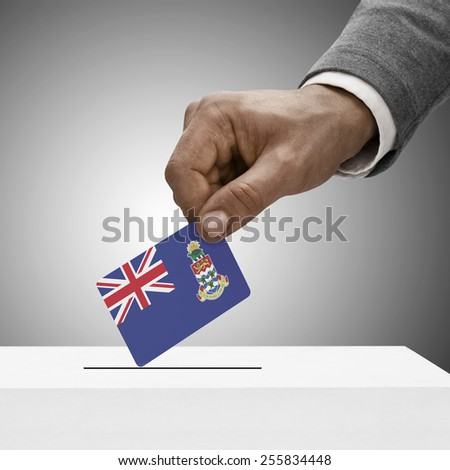 Black male holding flag. Voting concept - Cayman Islands - stock photo