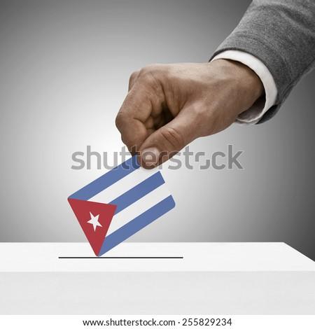 Black male holding flag. Voting concept - Cuba - stock photo