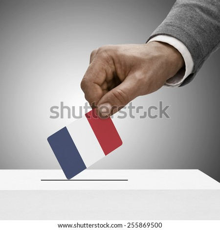 Black male holding flag. Voting concept - France - stock photo