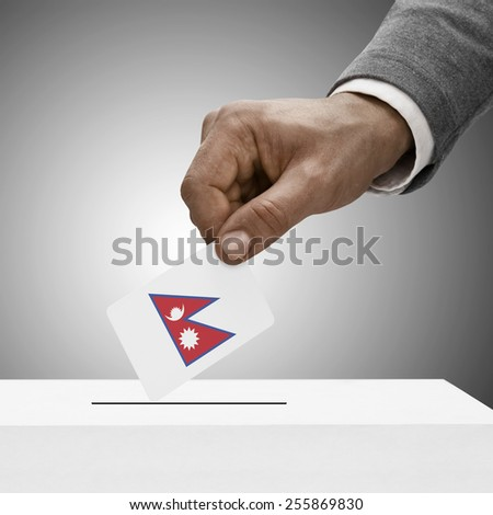 Black male holding flag. Voting concept - Nepal