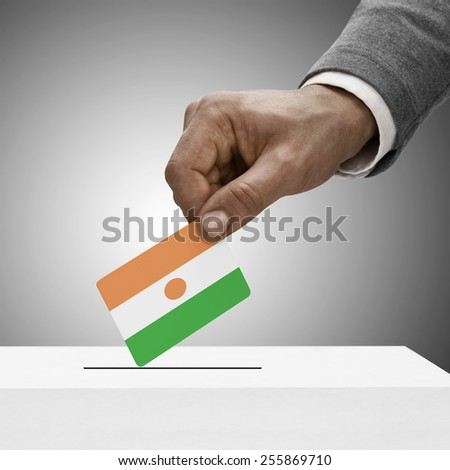 Black male holding flag. Voting concept - Niger - stock photo