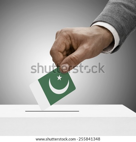 Black male holding flag. Voting concept - Pakistan - stock photo