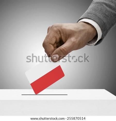 Black male holding flag. Voting concept - Poland - stock photo