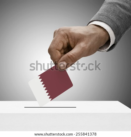 Black male holding flag. Voting concept - Qatar - stock photo