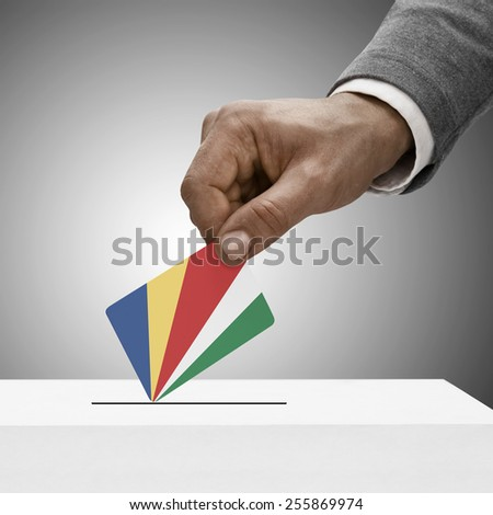 Black male holding flag. Voting concept - Republic of Seychelles - stock photo