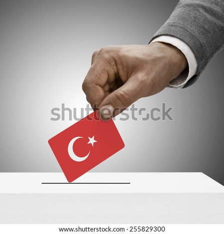 Black male holding flag. Voting concept - Turkey - stock photo
