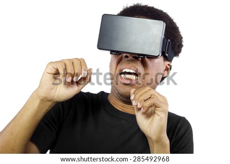 Black male wearing a virtual reality headset on a white background