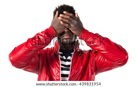 Black man covering his eyes - stock photo