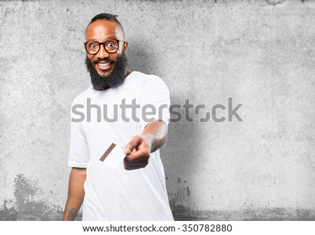 black man holding a credit card