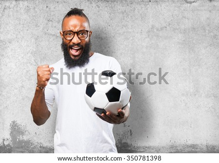 black man holding a soccer ball - stock photo