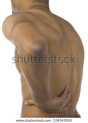 Black man holding his aching back - stock photo