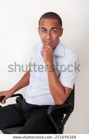 Black man in office chair - stock photo