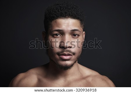 Black man on black background