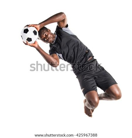 Black man playing football - stock photo