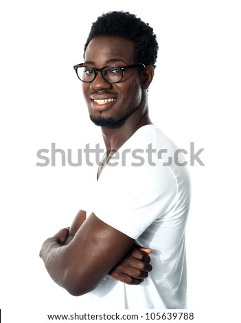 Black man posing with crossed arms and wearing glasses - stock photo