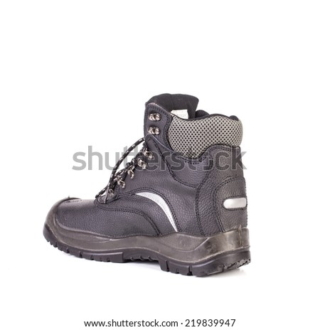 Black man's boot with grey inset. Isolated on a white background.