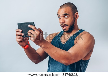black man with  digit plate - stock photo