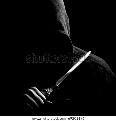 Black Man with knife in the dark - stock photo