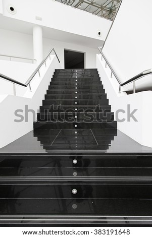 Black marble stairs, detail of a modern escaler - stock photo