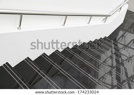 Black marble stairs, detail of stairs with metal railing and white, modern architecture, reflection and cleaning - stock photo