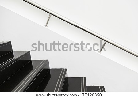 Black marble stairs, detail of the interior of a modernist building, modern architecture - stock photo