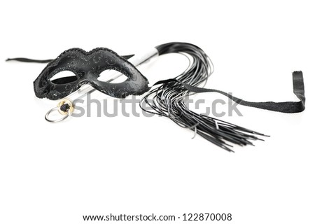 Black mask and a whip on white background - stock photo