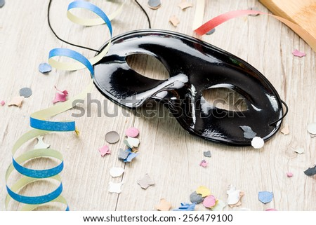 black mask carnival with streamers and confetti - stock photo