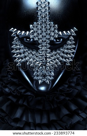black mask with iron spikes