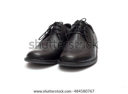 black men's shoes on a white background