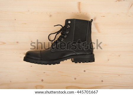 Black men's shoes on a wooden background
