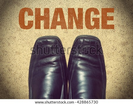 Black men shoes shoes with word Change - stock photo