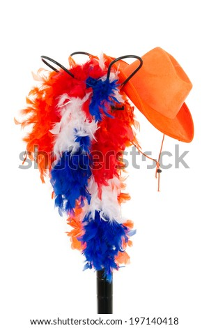 Black metal hat stand with Dutch supporter's attributes in the colors of the Dutch flag  - stock photo