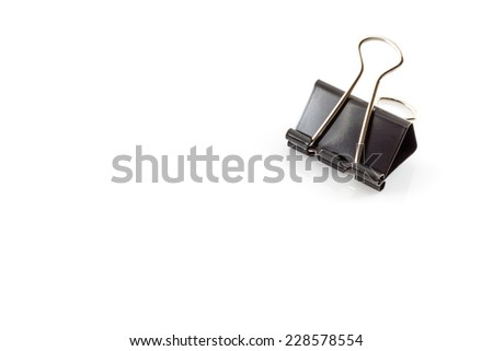 Black metal paperclips on white background